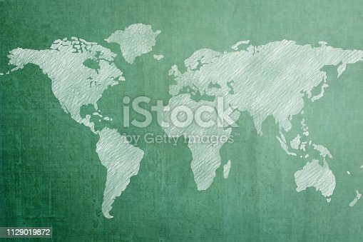 istock Green chalkboard with world map background 1129019872