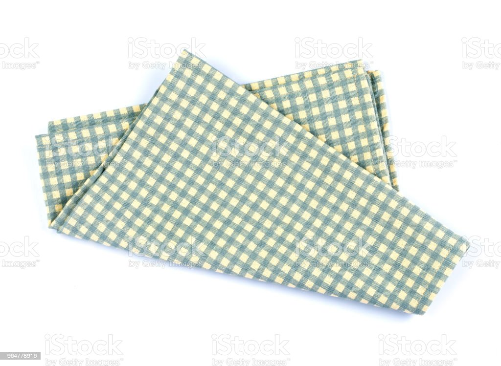green checkered napkin table clothes  on white background. royalty-free stock photo