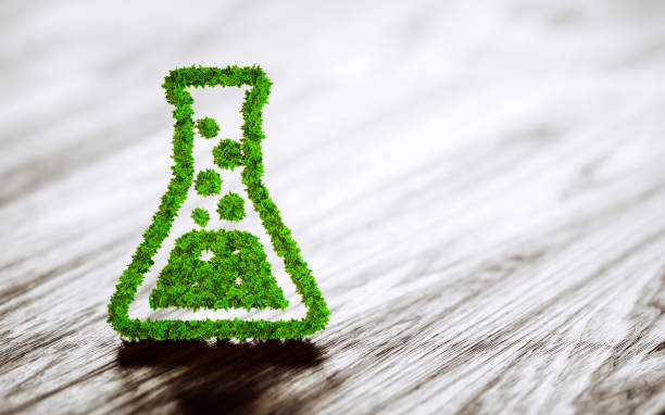 Green chemistry industry sign on black wooden background. stock photo