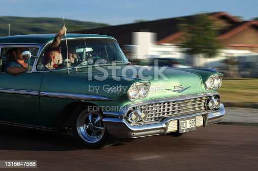 istock Green Chevrolet Impala 1958 old timer car. 1315647588