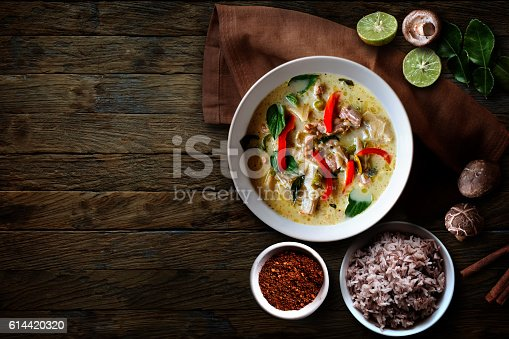 Green Chicken Curry over wooden table.Thai cuisine