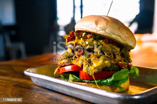 A fresh hot Green Chile Cheeseburger