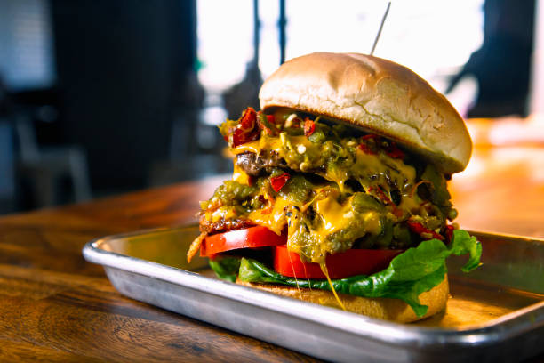 green chile cheeseburger - green chilli pepper stock photos and pictures
