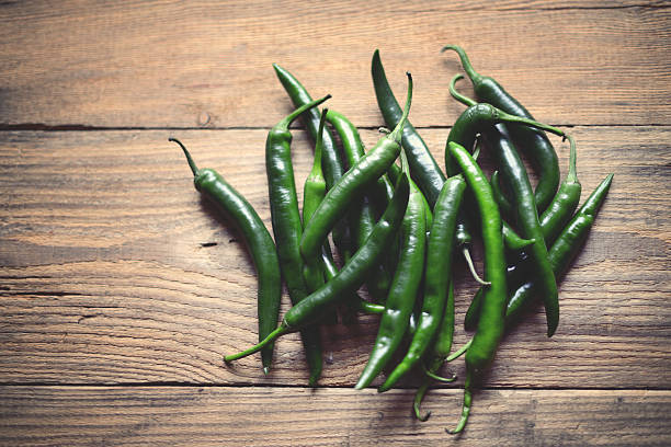 green chili peppers - green chilli pepper stock photos and pictures