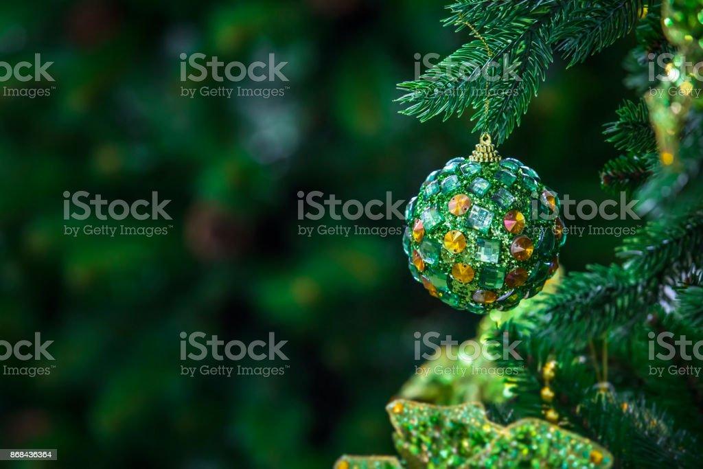 green christmas ball hanging on a Christmas tree, a modern ball...