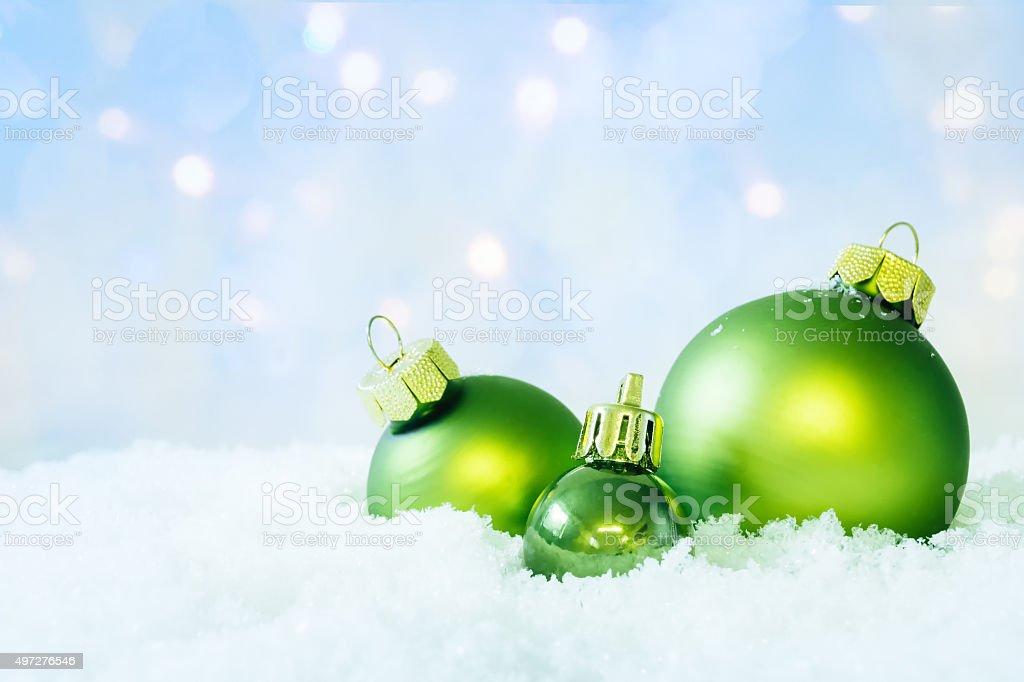 Green Christmas Balls on Snow stock photo