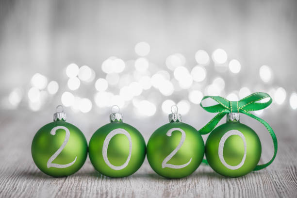 Green Christmas balls on White Rustic Wood Board 2020 year stock photo