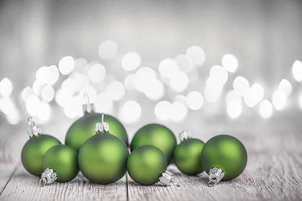 Green Christmas Balls on White Rustic Wood Board stock photo