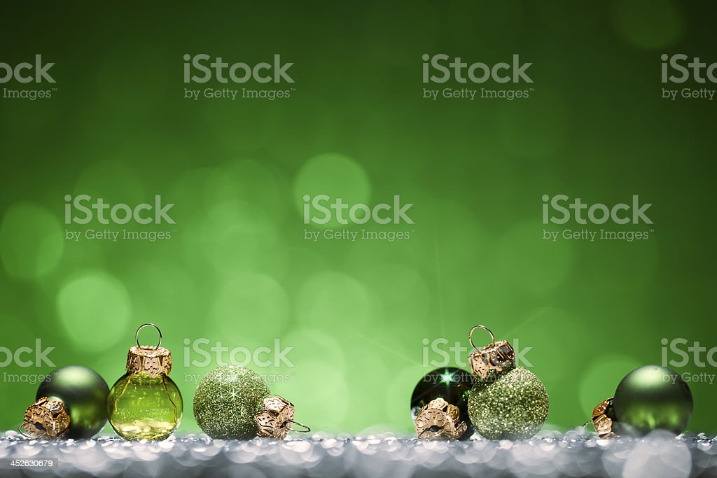 Green Christmas Baubles - Glitter Bokeh Season Holiday Background stock photo