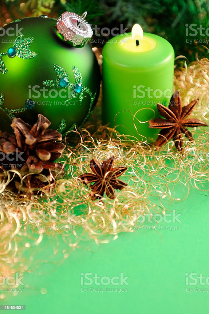 green christmas ornament and candle with copy space royalty free stock photo