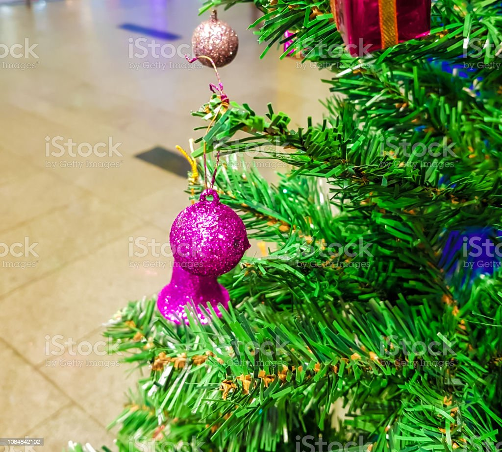 Green Christmas Tree Decorated With Colurful Balls Bells And Gift Boxes Stock Download Image Now