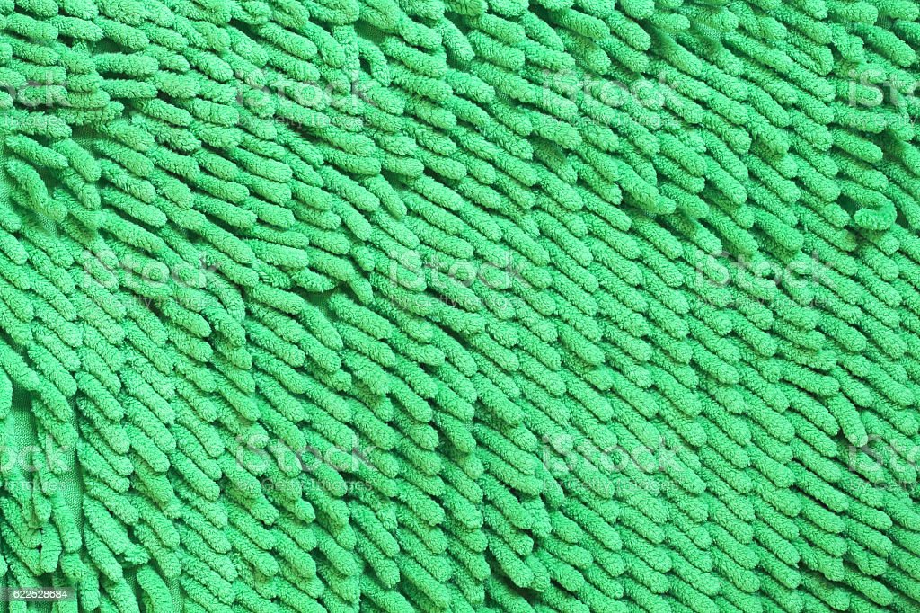 Green cleaning feet doormat or carpet texture stock photo