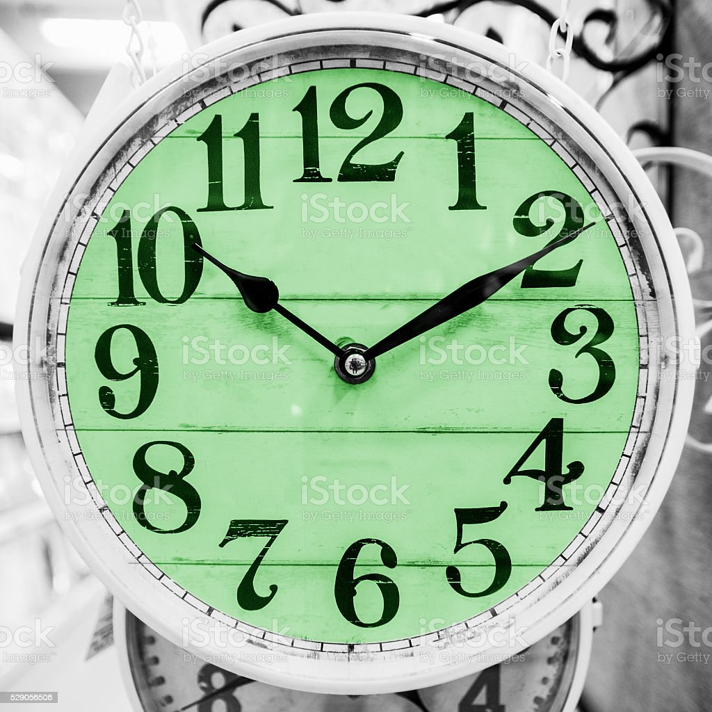Green clock in a classical style. stock photo