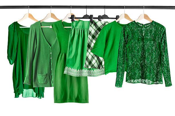 green clothes on clothes rack - damen rock kostüme stock-fotos und bilder