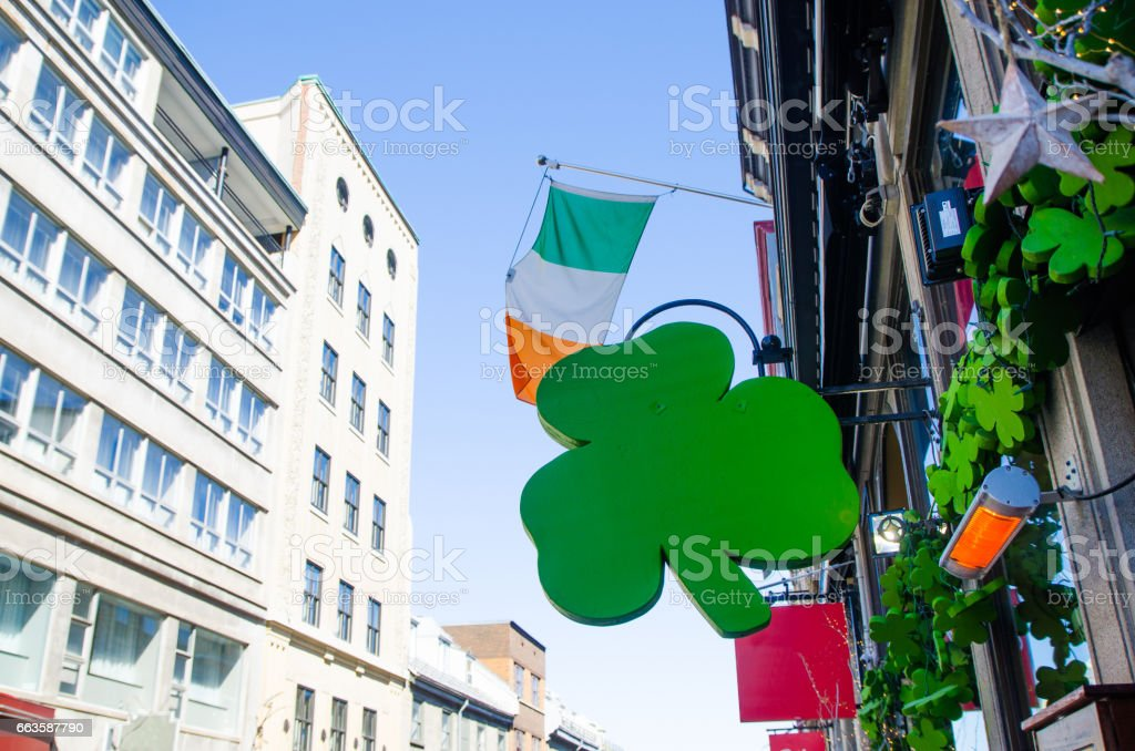 Green clover decoration and Irish flag for St-Patrick's day stock photo