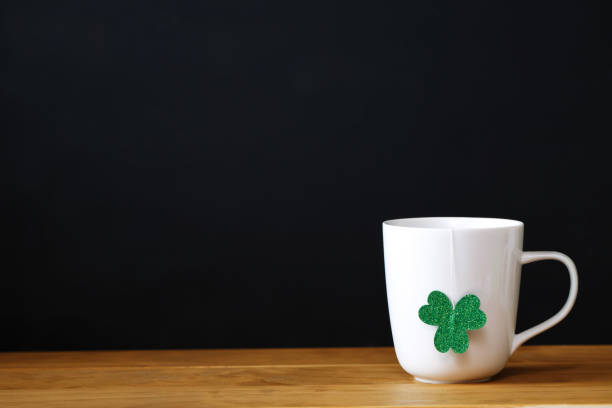 green clover with white mug - luck of the irish stock photos and pictures