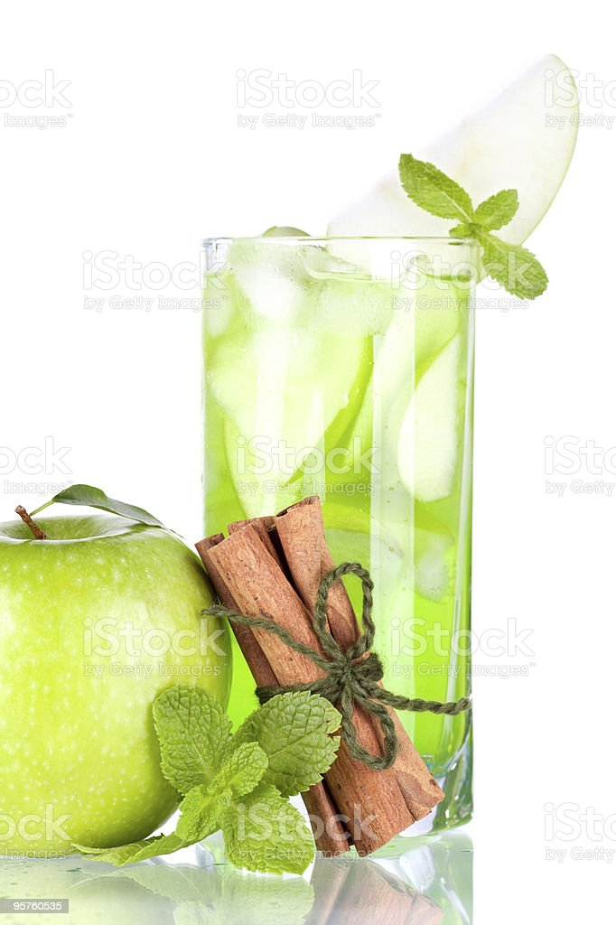 Green cocktail with apples, mint and cinnamon royalty-free stock photo