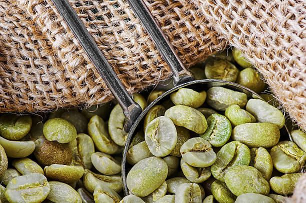 Green coffee beans in a jute bag stock photo