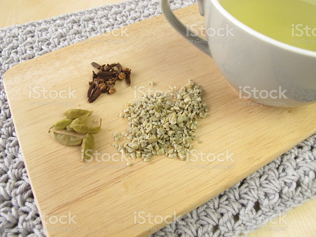 Green coffee with cardamom and cloves stock photo