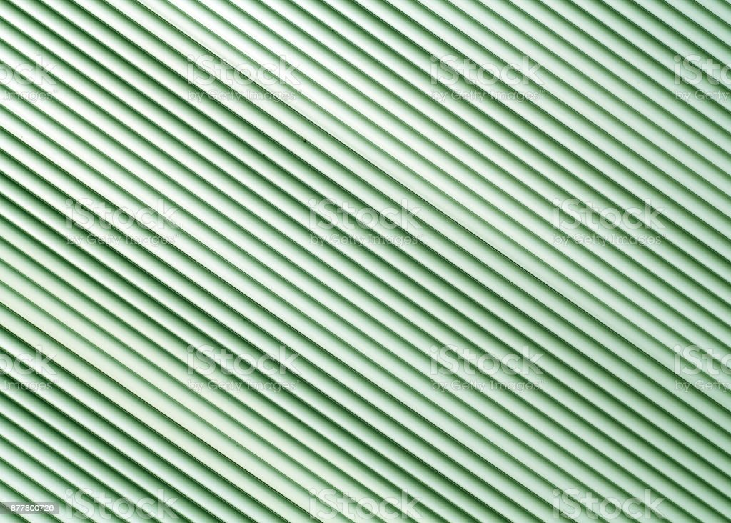 Green color metal warehouse wall pattern. stock photo