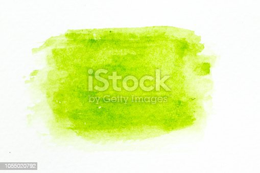 847999586 istock photo Green color watercolor handdrawing as brush on white paper background 1055020792