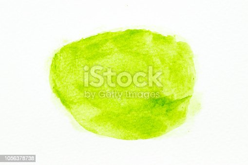 847999586 istock photo Green color watercolor handdrawing as brush on white paper background 1056378738