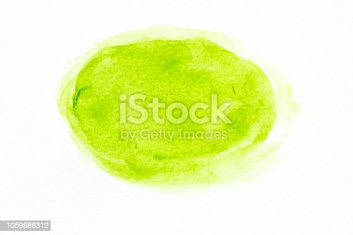 847999586 istock photo Green color watercolor handdrawing as brush on white paper background 1059686312
