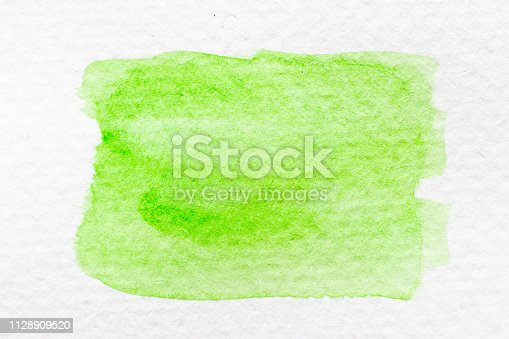 847999586 istock photo Green color watercolor handdrawing as brush or banner on white paper background 1128909520