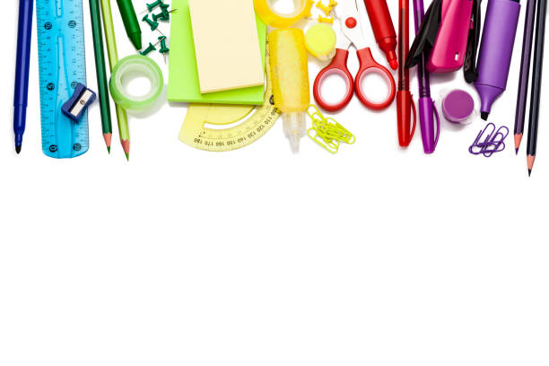 Green colored office or school supplies on white background stock photo