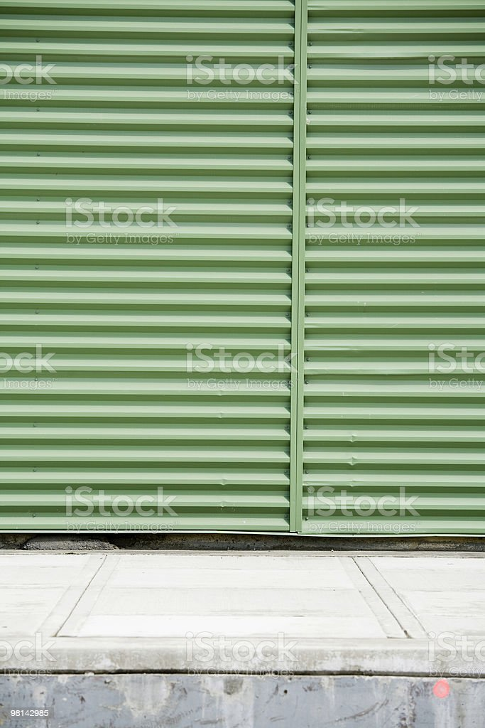 Green corrugated metal industrial warehouse door royalty-free stock photo