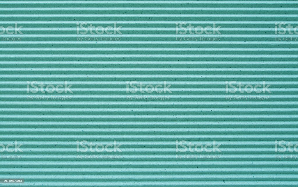 green corrugated paper background. stock photo
