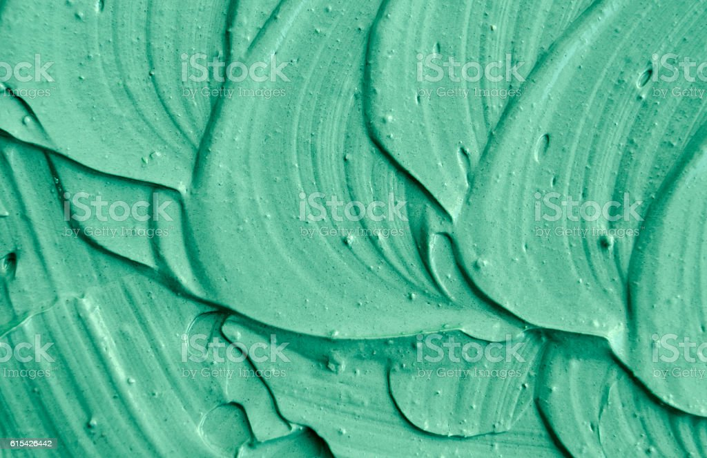 Green cosmetic clay texture close up. - Photo