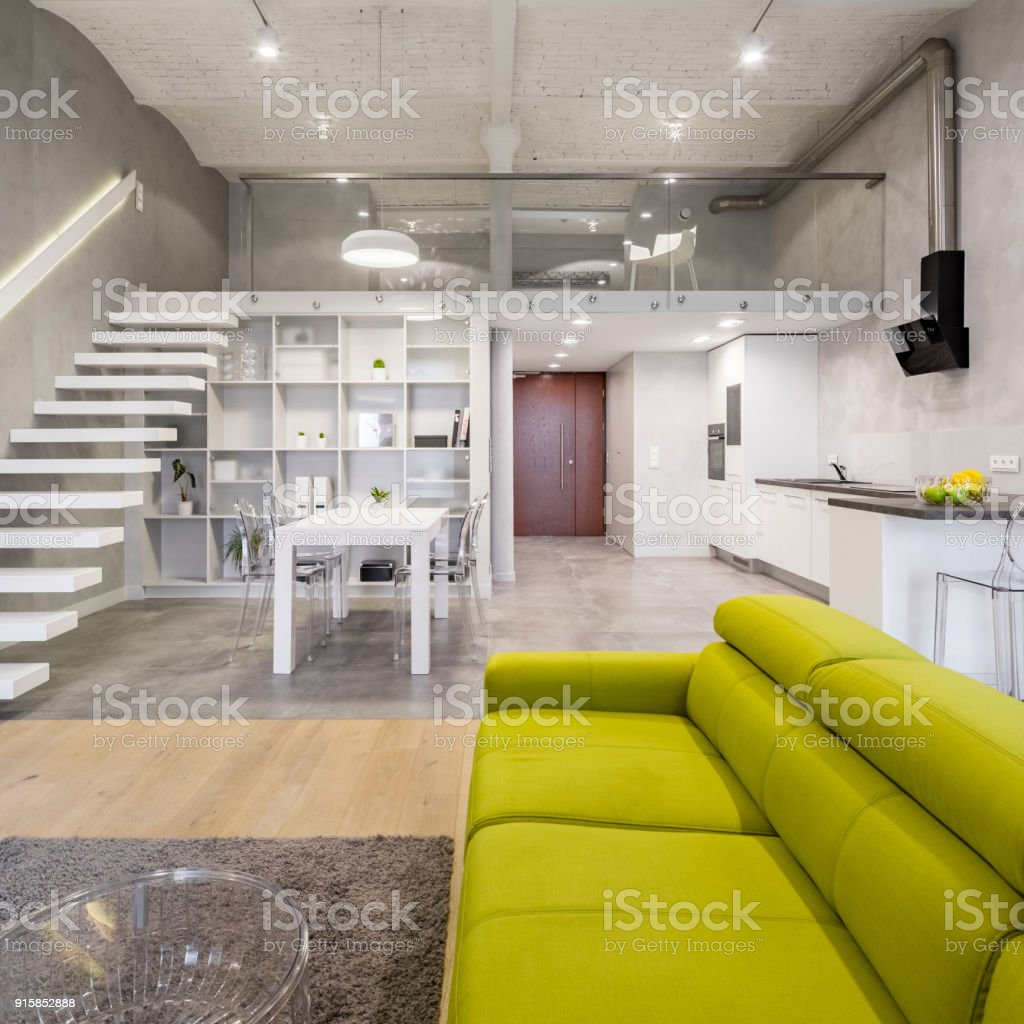 Green couch and transparent table stock photo