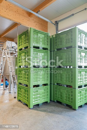 Crates stacked on top of each other in an industrial building.