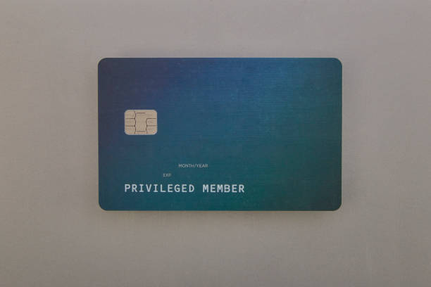 Green credit card on grey background stock photo