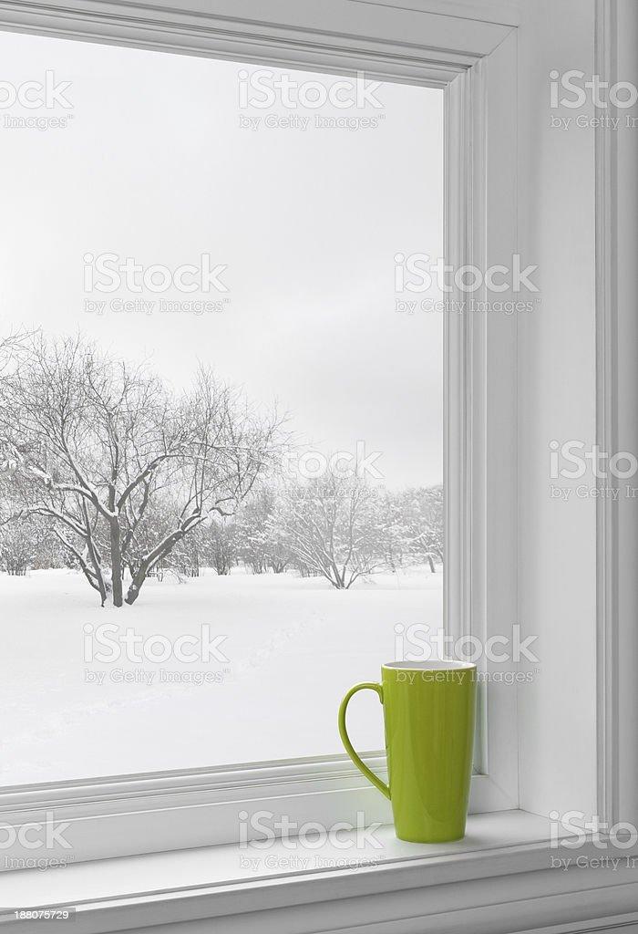 Green cup on a windowsill stock photo