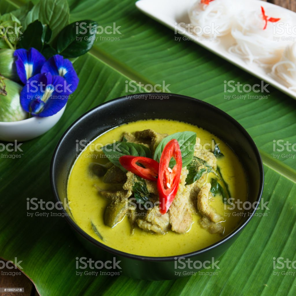 Green curry creamy coconut milk with chicken with thai rice noodle stock photo