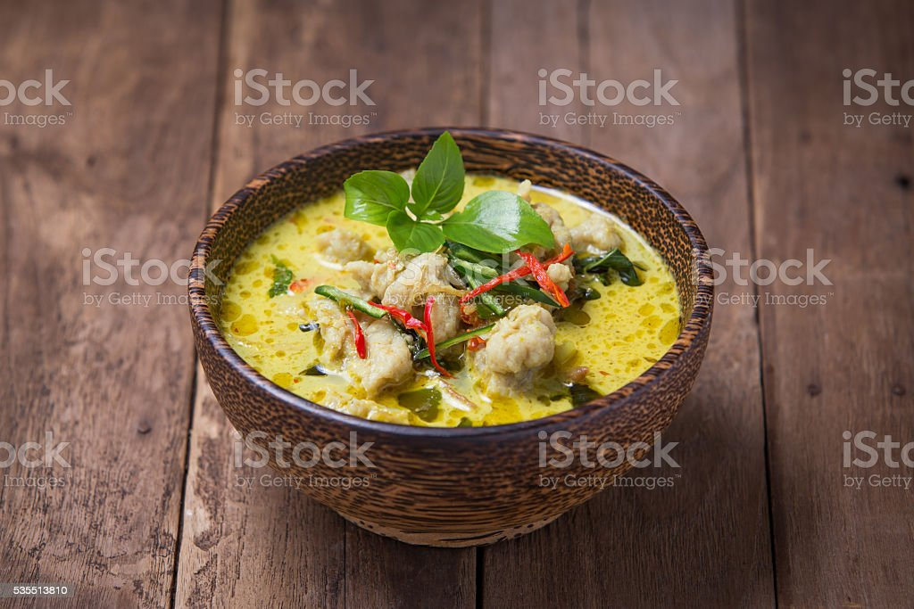 Green curry fish balls on wood background. stock photo