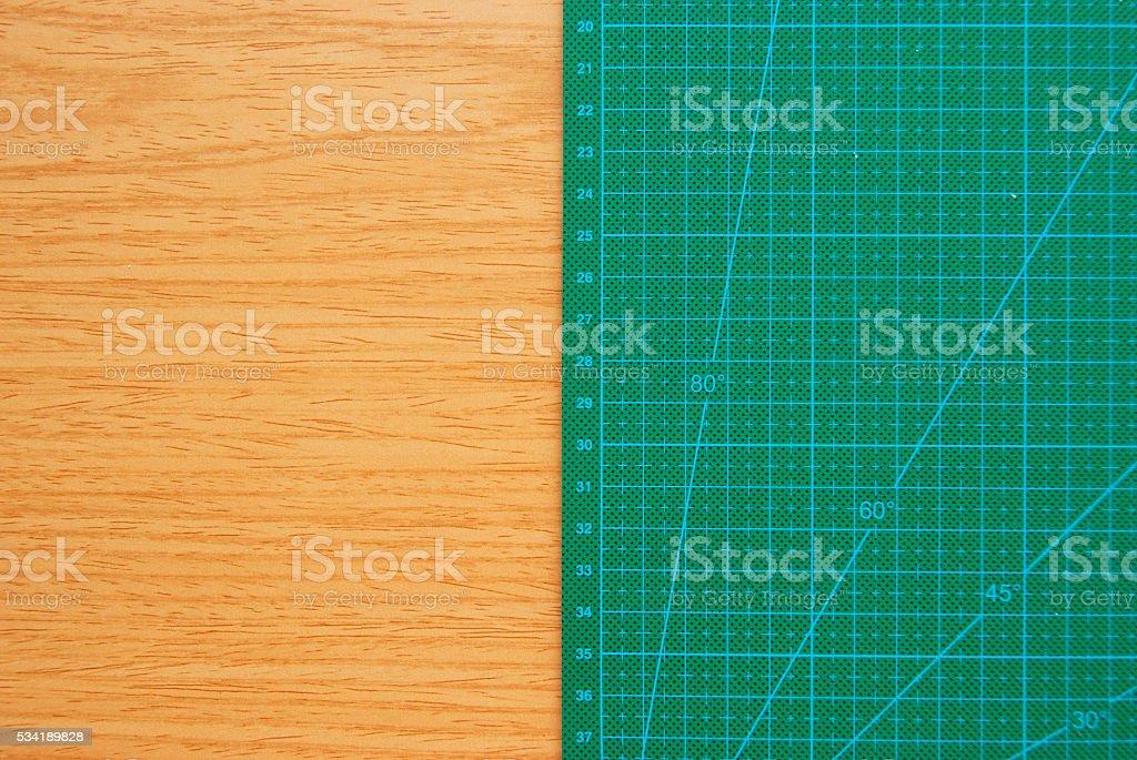 Green Cutting Mat on Wood Desk stock photo