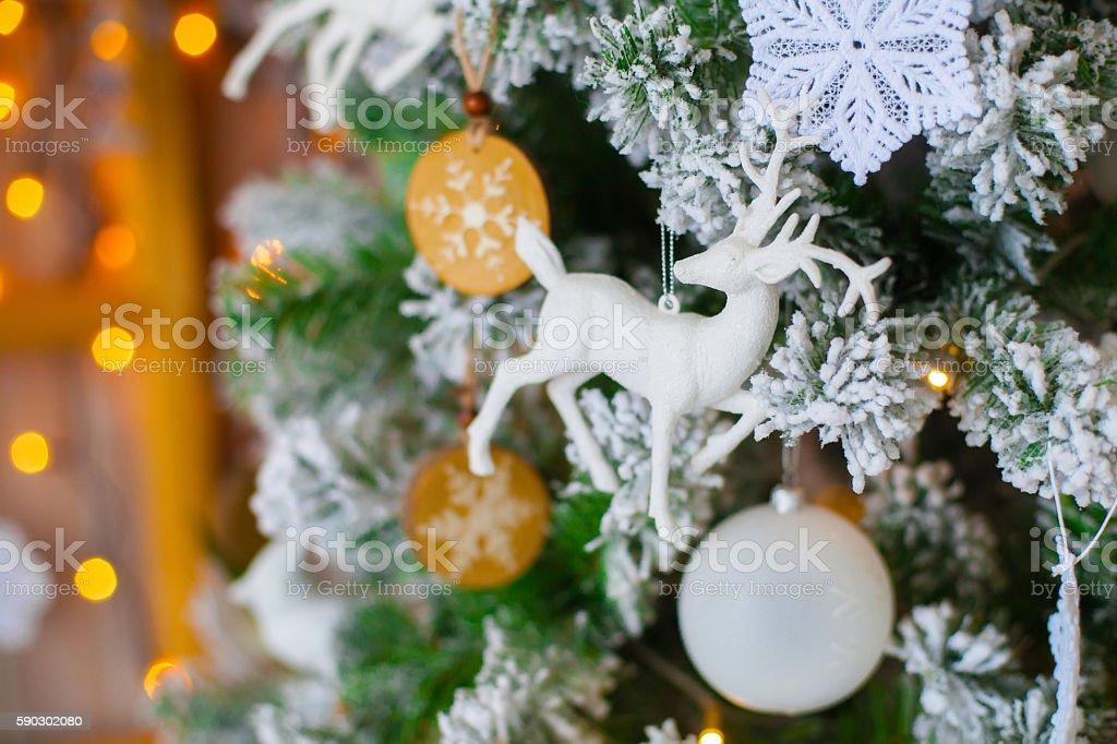 Green decorative christmas tree with figure of deer royaltyfri bildbanksbilder