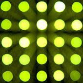 green defocused lights on dark background