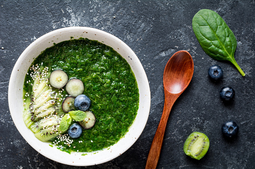 Green detox smoothie in bowl