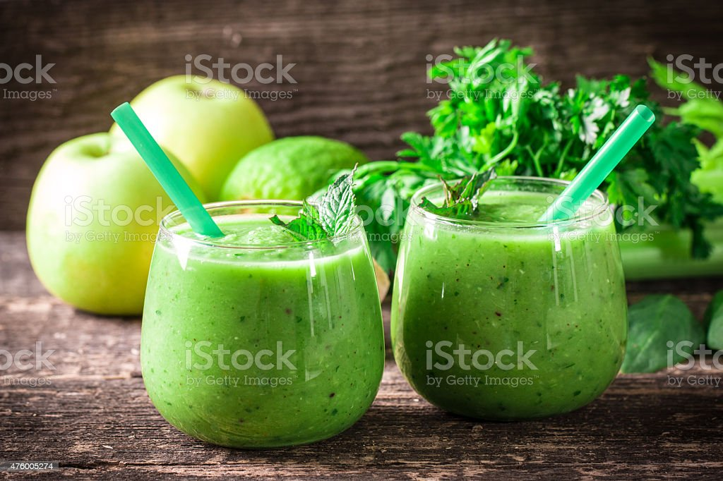 green Detox smoothie on wooden table stock photo