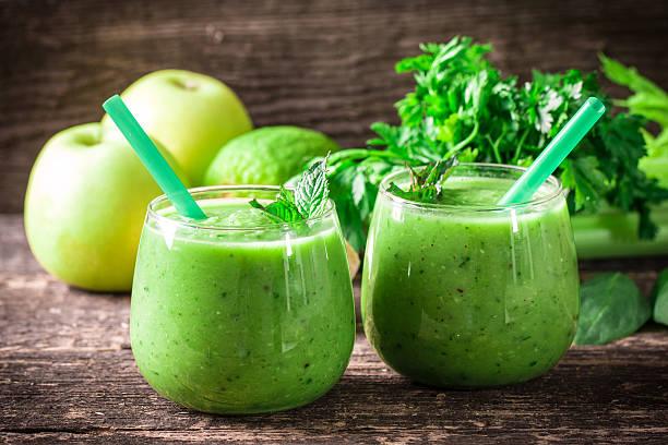 green Detox smoothie on wooden table stock photo