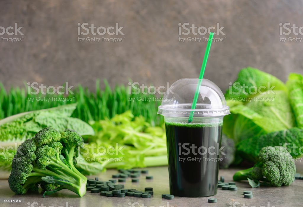 Green detox smoothies with spirulina and other greens stock photo