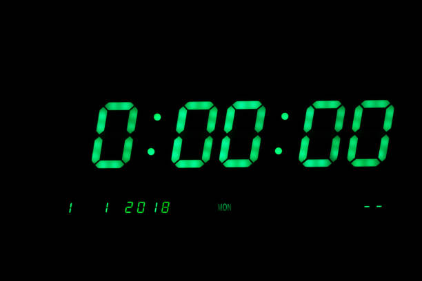 Green Digital LED Clock Showing The First Second of year 2018 on Black Background. stock photo