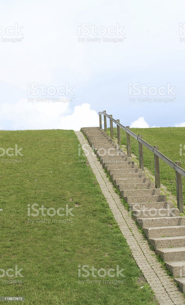 green dike with blue sky stock photo