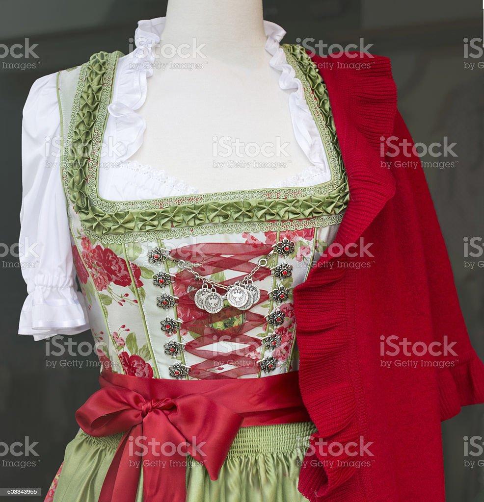 Green Dirndl dress with red bolero stock photo