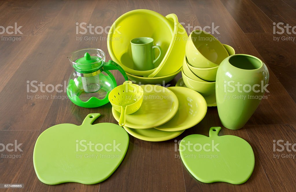 green dishes on a dark wood floor royalty-free stock photo