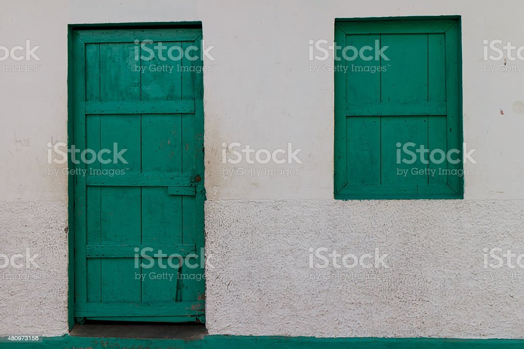 green door and window from house stock photo